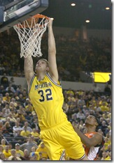 Alan Warren, The Ann Arbor News Michigan's Zack Gibson goes in for a dunk against Illinois during the second half at Crisler Arena in Ann Arbor on Sunday.