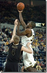 LON HORWEDEL,THE ANN ARBOR NEWS  Michigan's DeShawn Sims, right, drops in two of his game-high 29 points over Purdue's Robbie Hummel during first half action of the Wolverine's  much needed 87-78 win over the Boilermakers, Thursday night, February 26th at UM's Crisler Arena.