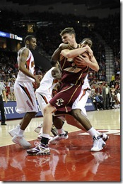 27 January 2009: Boston College forward Joe Trapani (12) pulls down one of his game high 9 rebounds in the 2nd half against Maryland forward Dino Gregory (33) at the Comcast Center in College Park, Maryland.  The Boston College Eagles defeated the Maryland Terrapins 76-67 after overcoming an 11 point halftime lead by the Terrapins.