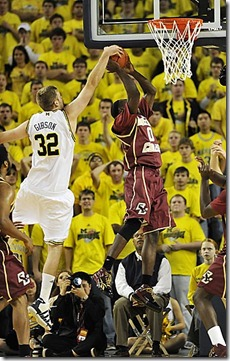 (caption) Michigan's Zack Gibson blocks a shot by BC's Reggie Jackson, but gets called for a foul on the play in the second half.  ***  Boston College defeated the University of Michigan 62-58 in an ACC Challenge game that wasn't as close as the final score. Boston College led nearly the entire game, most of it by a wide margin before Michigan made it close at the end at Crisler Arena in Ann Arbor.  The Photos taken on Wednesday, December 2, 2009. ( John T. Greilick / The Detroit News )