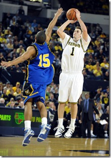 Michigan's Stu Douglass pops in two of his game-high 20 points over Coppin State's George Jackson during second half action of the Wolverine's 76-46 thumping of Coppin State, Tuesday night, December 22nd at UM's Crisler Arena. Lon Horwedel | AnnArbor.com