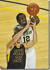 (caption) Michigan's Anthony Wright battles Iowa's Eric May for a rebound in the second half.  *** The Michigan Wolverines dominated from start to finish in a 60-46 victory over the Iowa Hawkeyes at Crisler Arena in Ann Arbor. DeShawn Sims had 20 points and 12 rebounds, while Manny Harris scored 20 points and six boards. Photos taken on Saturday, January 30, 2010. ( John T. Greilick / The Detroit News )