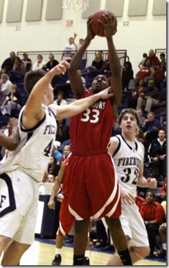 Wayne's Markus Crider is all over he rebound against Fairmont at Kettering's Fairmont High School on Friday Dec. 12.