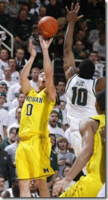 Michigans-Zach-Novak-left-shoots-a-three-point[1]