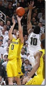 Michigans-Zach-Novak-left-shoots-a-three-point[1]